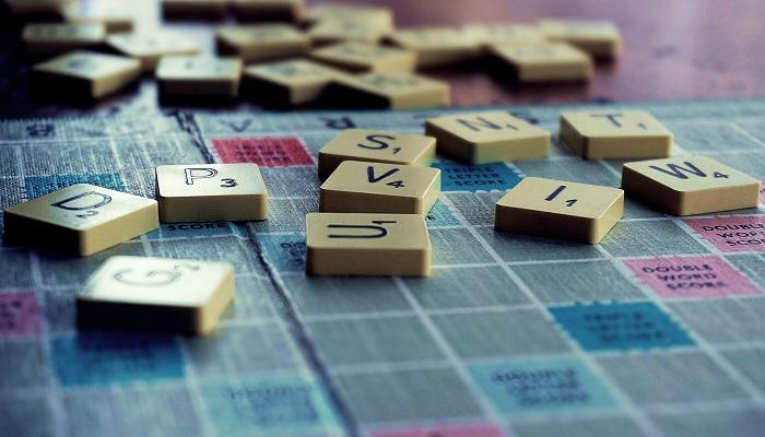 scrabble pieces on a scrabble board